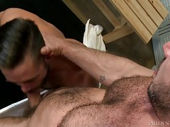 Mike`s ass is lubed and ready for a big dick so Marc pushes in deep and starts to give Mike the fucking of his life in the locker room.