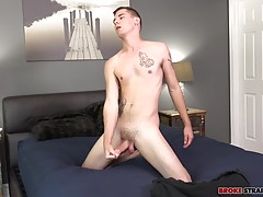 He grinds his member against the bed, then stands up to work his meat from another angle until he lies back on the bed and really gets into it.  He jerks his cock with one and feels his body up with his free hand, running it across his chest and balls as